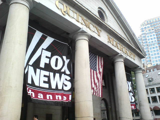 A Fox News banner hangs in Quincy Market in Boston, Massachusetts. (mroach/flickr)