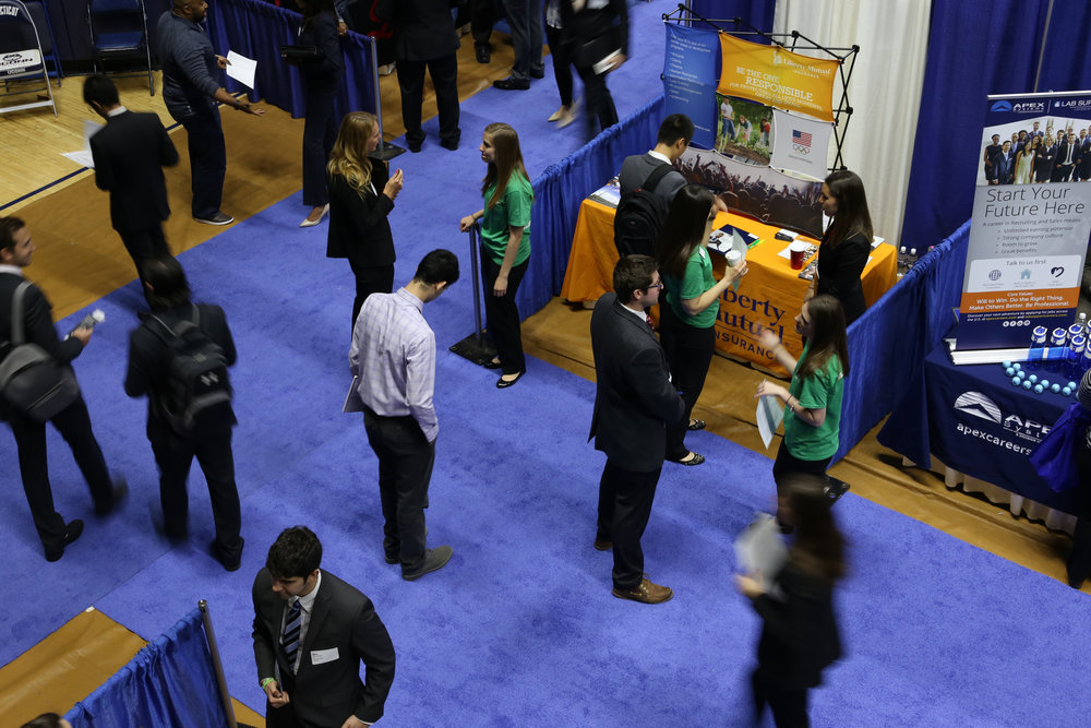 Students look for a full-time job during the Spring Career Fair in Gampel Pavilion on Wednesday, March 30, 2016. Students currently looking for jobs should consider using Serve Here CT, a non-profit based in Old Saybrook that looks to match millennials with jobs at local non-profits in the state. (Jackson Haigis/The Daily Campus)