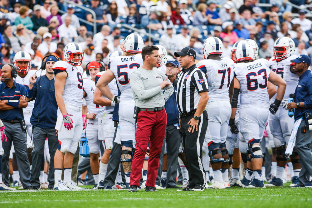 Head coach Bob Diaco talks to a referee during the Huskies 20-9 victory over Cincinnati on Saturday, Oct. 8, 2016. Diaco addressed the shifting role of the secondary over throughout this season. (Jason Jiang/The Daily Campus)