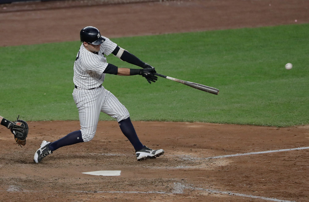 New York Yankees' Austin Romine connects for a base hit to drive in two runs against the Baltimore Orioles during the eighth inning of a baseball game, Saturday, Oct. 1, 2016, in New York. The Yankees won 7-3. (Julie Jacobson/AP)