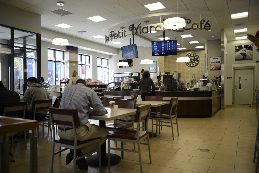 "UConn students and faculty enjoy an afternoon café visit to the new Starbucks in the UConn bookstore on Wednesday, Oct. 12 2016. The sign remains unchanged from the previous café, ""Le Petit Marche."" (Jason Jiang/The Daily Campus)"