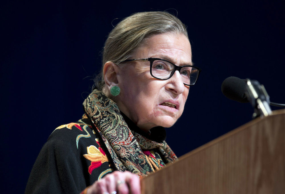 "In this Jan. 28, 2016 file photo, Supreme Court Justice Ruth Bader Ginsburg speaks at Brandeis University in Waltham, Mass. Ginsburg is calling the protests of football players who decline to stand for the national anthem ""dumb and disrespectful."" (Michael Dwyer, File/AP)"