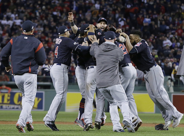 The Cleveland Indians celebrate their 4-3 win over the Boston Red Sox in Game 3 of baseball's American League Division Series, Monday, Oct. 10, 2016, in Boston at Fenway Park. Cleveland swept the Red Sox and is moving on to the ALCS. (Elise Amendola/AP Photo)