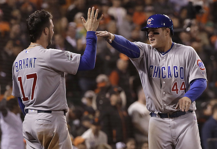 Chicago Cubs' Kris Bryant (17) and Anthony Rizzo (44) celebrate during the ninth inning of Game 4 of baseball's National League Division Series against the San Francisco Giants in San Francisco, Tuesday, Oct. 11, 2016. The Cubs are favorites to break their 108-year curse and win the World Series. (Marcio Jose Sanchez/AP Photo)