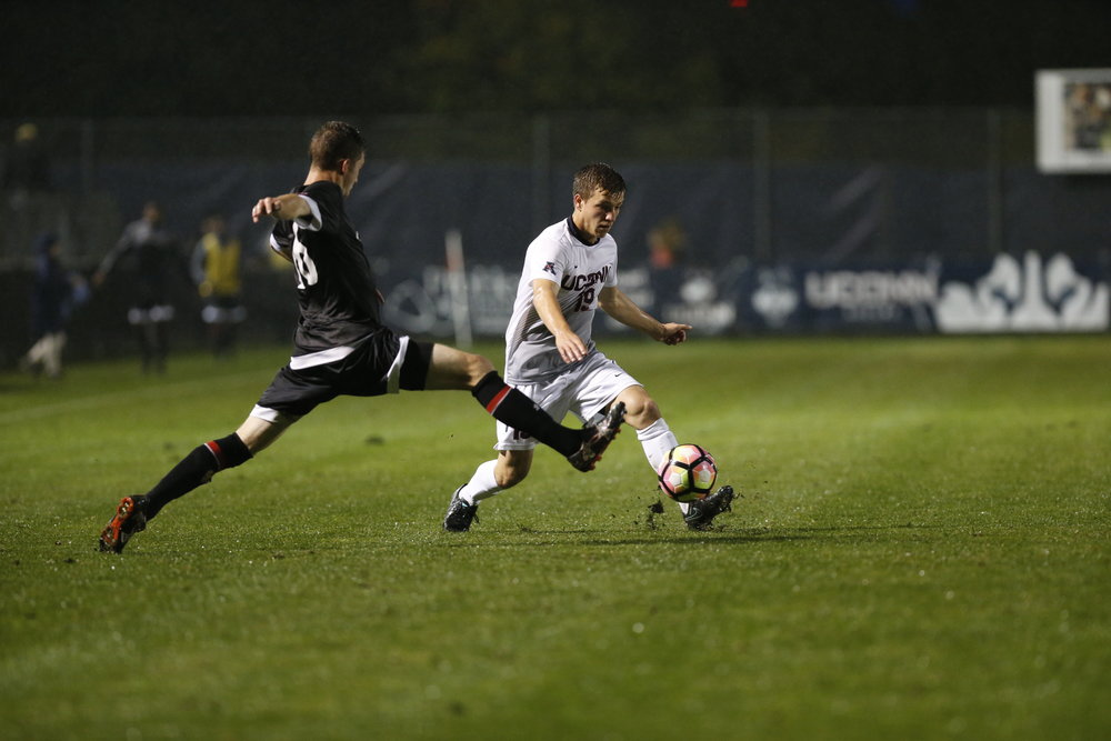 UConn freshman midfielder Niko Petridis (#19) sidesteps a defender in UConn's game against Cincinnati on Saturday Oct. 8, 2016 at Joseph J. Morrone Stadium. The Huskies won 5-0. (Tyler Benton/The Daily Campus)