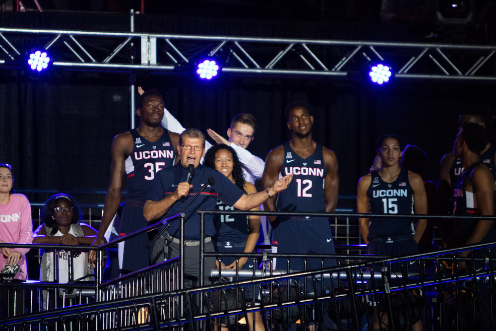 "Geno Auriemma speaks to the crowd during First Night on Friday, Oct. 14 at Gampel Pavilion. He pumped up the crowd by calling basketball season ""the best time of your life."" (Jackson Haigis/The Daily Campus)"