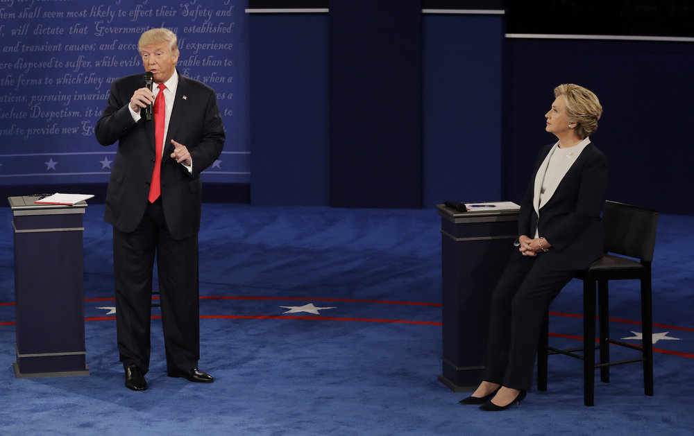 Democratic presidential nominee Hillary Clinton   listens to Republican presidential nominee Donald Trump   during the second presidential debate at Washington University in St. Louis, Sunday, Oct. 9, 2016. (Patrick Semansky/AP)