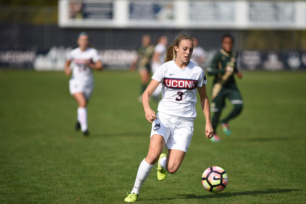 Senior, Rachel Hill, dribbles at her last college home game on Sunday, Oct. 16 against USF.  Hill scored a header later in the game to give UConn a 3-0 lead.  (Charlotte Lao/The Daily Campus)