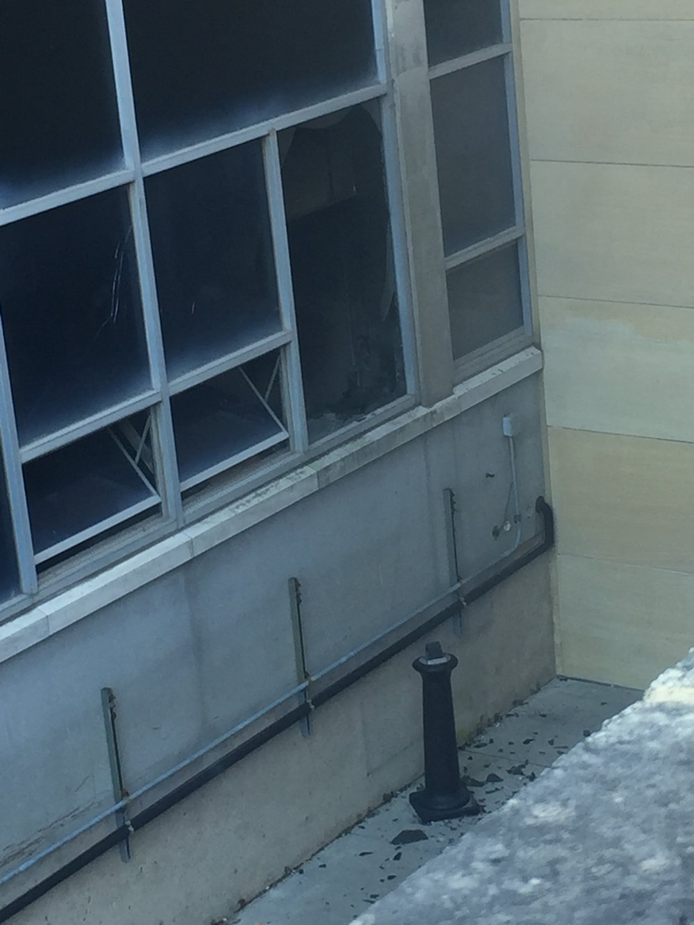 A broken window with smoke coming out at TLS building around 2:30 p.m. on Tuesday, Oct. 18, 2016. (Courtesy/Madie James)