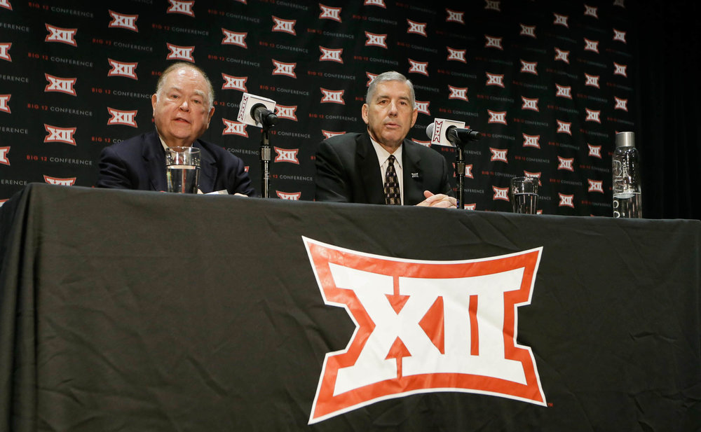 Big 12 Commissioner Bob Bowlsby, right, and Oklahoma President David Boren speak to reporters after TheBig 12 Conference meeting in Grapevine, Texas, Monday, Oct. 17, 2016. The Big 12 Conference has decided against expansion from its current 10 schools after three months of analyzing, vetting and interviewing possible new members. (LM Otero/AP)