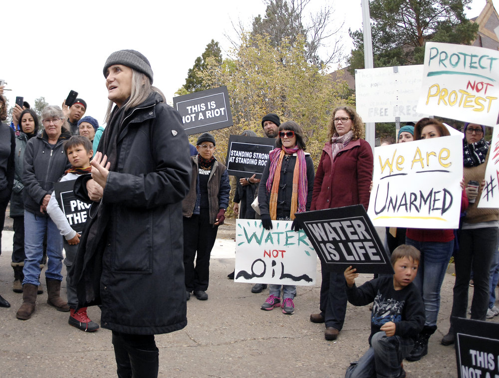 Journalist Amy Goodman, left, speaks with supporters in Mandan, North Dakota before learning the rioting charge filed against her was dismissed by a SouthCentral district judge Monday, Oct. 17, 2016. (Mike McCleary/AP Photo)