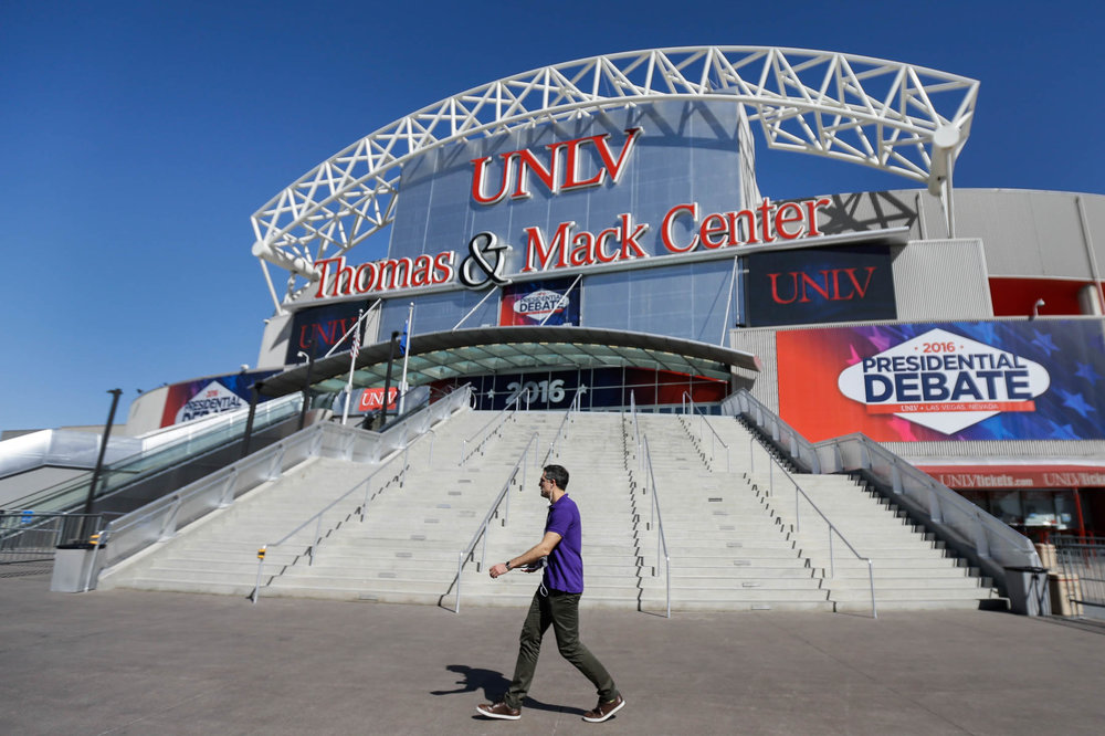 A pedestrian walks past the site for the third presidential debate between Republican presidential nominee Donald Trump and Democratic presidential nominee Hillary Clinton at UNLV in Las Vegas, Tuesday, Oct. 18, 2016. (Julio Cortez/AP)