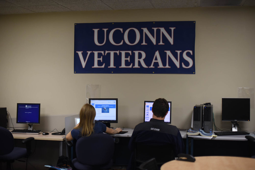 Students work on computers in the Veterans Oasis in the Student Union, one of many resources made available by the UConn Office of Veterans Affairs and Military Programs. The office is hosting it's fourth annual shelter drive between Nov. 14 and Dec. 2. (Zhelun Lang/The Daily Campus)