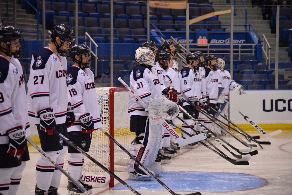 The Huskies line up ahead of their 4-0 victory over Alabama-Huntsville on Saturday, Oct. 8, 2016 at the XL Center in Hartford. The team will take on in-state rival Quinnipiac University on Wednesday, Oct. 19, 2016 at High Point Solutions Arena in Hamden. (Amar Batra/The Daily Campus)