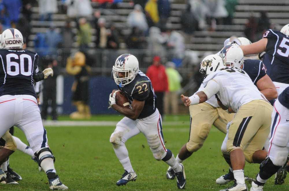 "UConn running back Arkeel Newsome carries the ball during the first ""Civil Conflict"" against UCF on November 1, 2014 at Rentschler Field in Hartford. Following the game, head coach Bob Diaco decided to create a rivalry between the Huskies and the Knights. (File Photo/The Daily Campus)"
