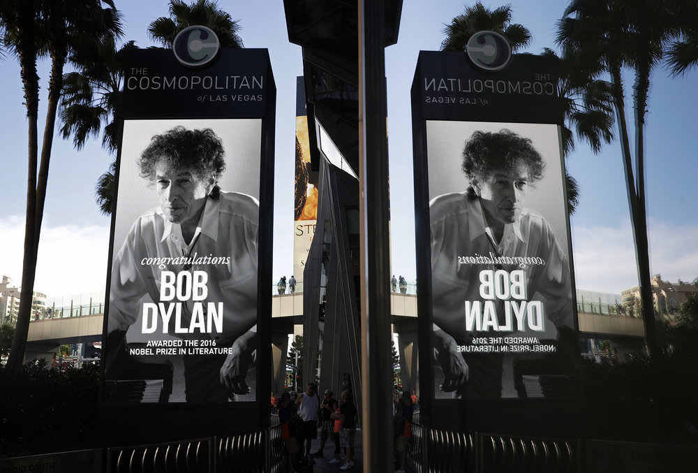"A sign outside of the Cosmopolitan of Las Vegas congratulates  Bob   Dylan , Thursday, Oct. 13, 2016, in Las Vegas.  Dylan  won the 2016  Nobel   Prize  in literature on Thursday, Oct. 13, 2016, a stunning announcement that for the first time bestowed the prestigious award on a musician for ""having created new poetic expressions within the great American song tradition."" (  John Locher/AP Photo)"