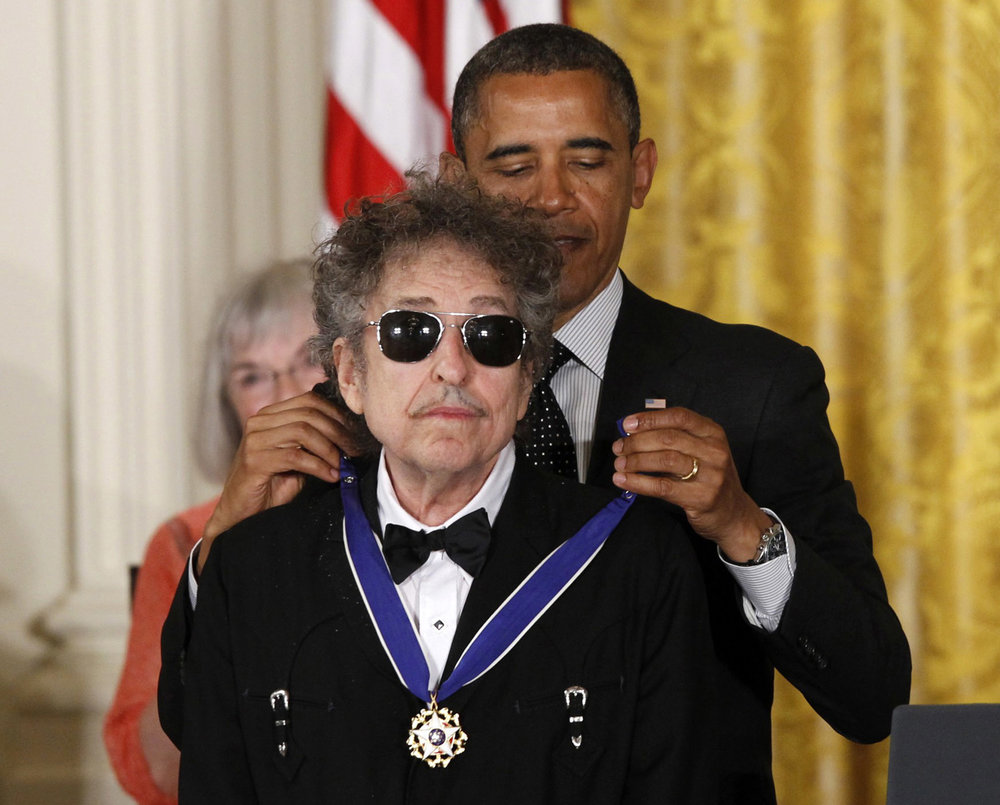 In this May 29, 2012, file photo, President Barack Obama presents rock legend Bob Dylan with a Medal of Freedom during a ceremony at the White House in Washington. Dylan won the 2016 Nobel Prize in literature, announced Thursday, Oct. 13, 2016. (Charles Dharapak/AP)