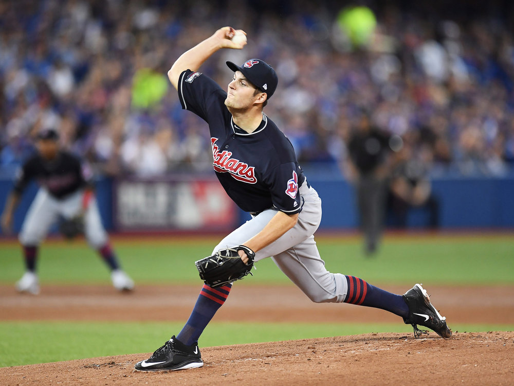 Cleveland Indians starting pitcher TrevorBauerdelivers to the Toronto Blue Jays during first inning of game three American League Championship Series baseball action in Toronto on Monday, Oct. 17, 2016. (Frank Gunn/Alternative Press)
