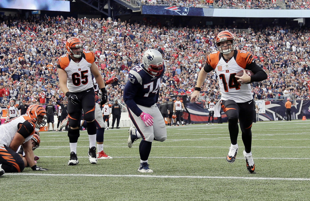 Cincinnati Bengals quarterback Andy Dalton (14) runs past New England Patriots defensive lineman Woodrow Hamilton (74) for a touchdown during the first half of an NFL football game, Sunday, Oct. 16, 2016, in Foxborough, Mass. (Elise Amendola/AP)