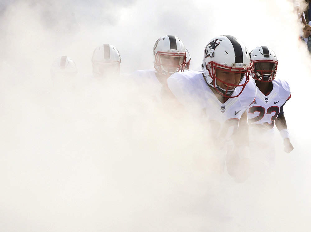 Connecticut players take the field before their 20-9 win over Cincinnati in an NCAA football game Saturday, Oct. 8, 2016, in East Hartford, Conn. UConn continues as part of the American Athletic Conference while holding out for a position in the Big 12 (  Winslow Townson/AP)