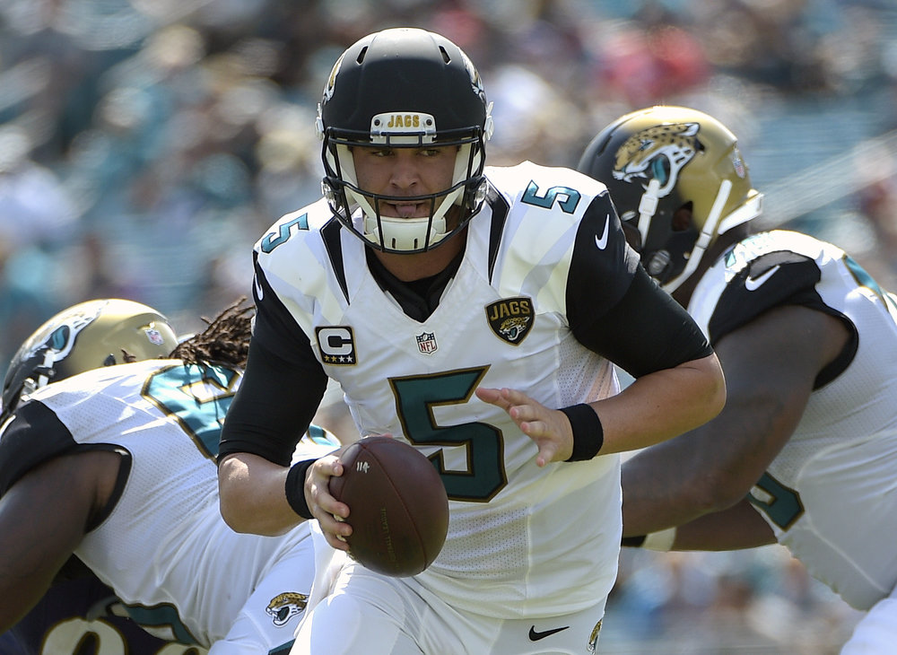 In this Sept. 15, 2016, file photo, Jacksonville Jaguars quarterback Blake Bortles(5) prepares to hand the ball off to running back T.J. Yeldon (24) during the second half of an NFL football game against the Baltimore Ravens, in Jacksonville, Fla. Bortles is one of the recent NFL drafts from UCF.  (Phelan M. Ebenhack/AP)