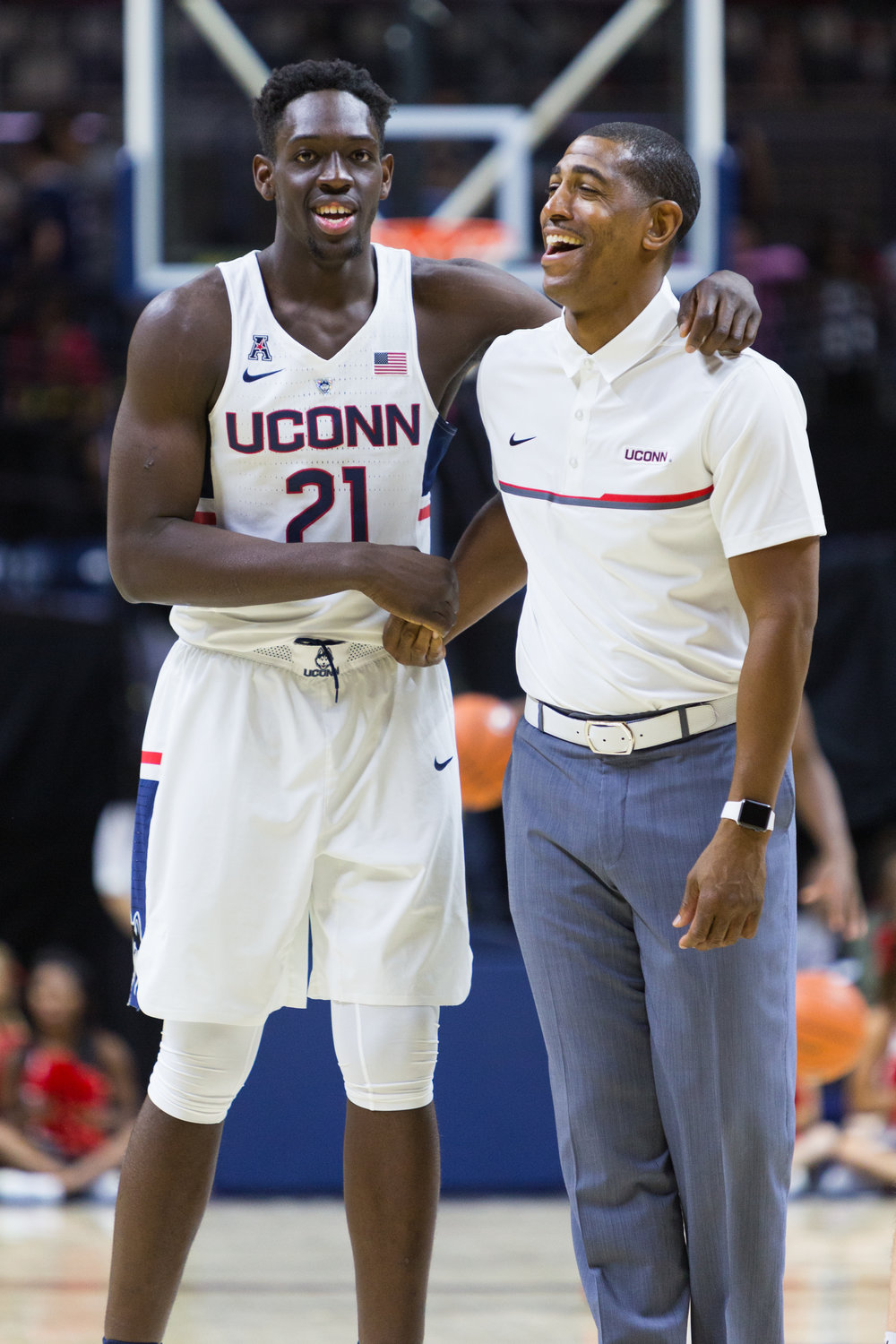UConn head coach Kevin Ollie and freshman forward Mamadou Diarra shared a laugh during warm-ups.