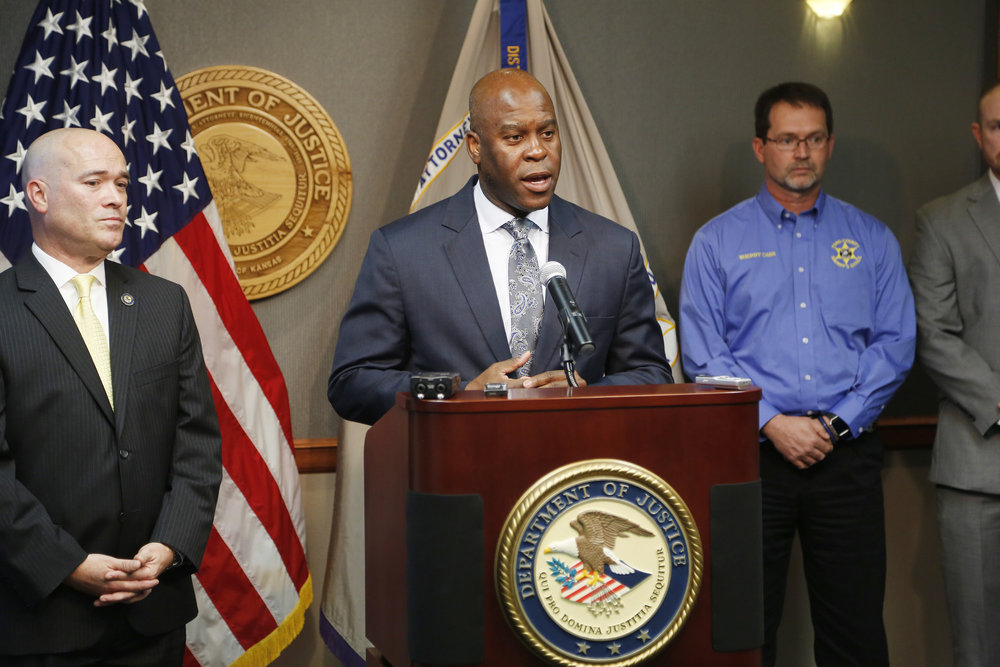 FBI Special Agent in Charge Eric Jackson talks about the FBI's roll in stopping a bomb plot. Acting U.S. Attorney Tom Beall (left) announced Friday a major federal investigation stopped a domestic terrorism plot by a militia group to detonate a bomb at a Garden City apartment complex where a number of Somalis live. (Bo Rader/AP)