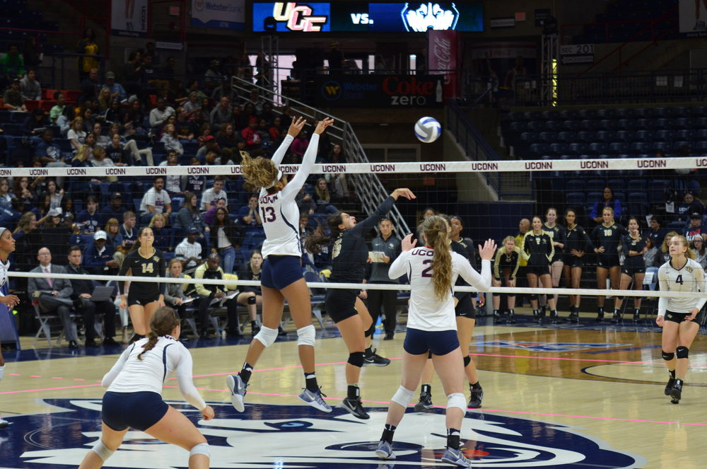 UConn Women's volleyball faced off against UCF on Friday, October 14. Despite strong defense, the women's team was defeated. Junior Tosin Adeniyi (#13) jumps to block a pass. (Akshara Thejawsi/ The Daily Campus)