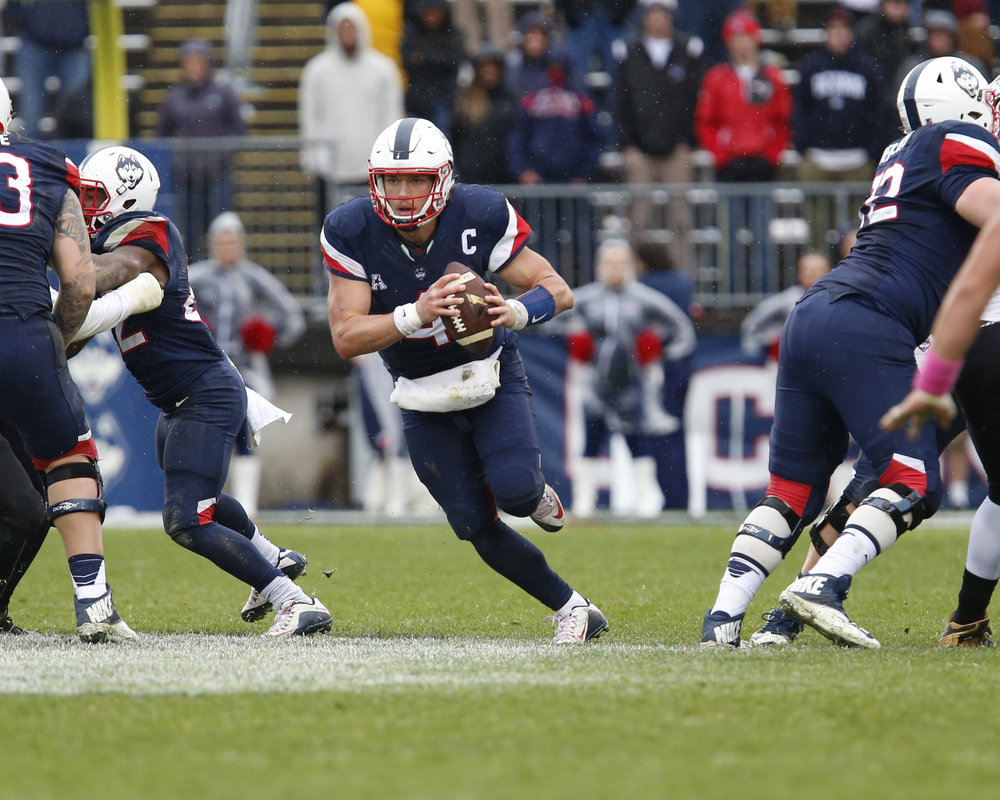 UConn Quarterback Bryant Shirreffs runs the ball after he can't find a receiver open.(Tyler Benton/The Daily Campus)