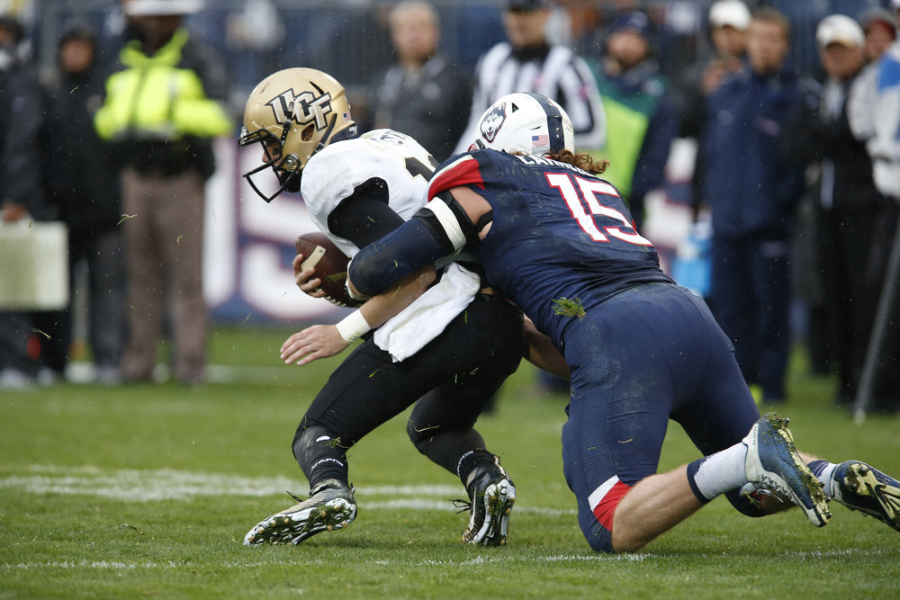UConn Junior Linebacker Luke Carrezola (15) makes a late game tackle to stop UCF runner from scoring.(Tyler Benton/The Daily Campus)