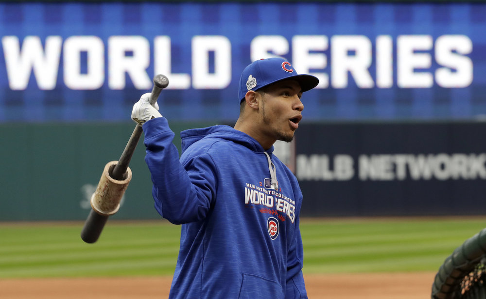 Chicago Cubs catcher Willson Contreras warms up during a team practice for baseball's upcoming World Series against the Cleveland Indians on Monday, Oct. 24, 2016 in Cleveland. (David J. Phillip/AP Photo)