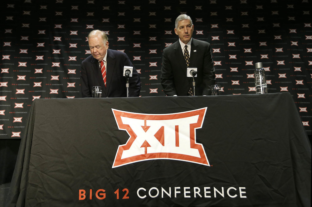 Big 12 Commissioner Bob Bowlsby, right, and Oklahoma President David Boren take their seat to speak to reporter after The Big 12 Conference meeting in Grapevine, Texas, Monday, Oct. 17, 2016. The Big 12 Conference has decided against expansion from its current 10 schools after three months of analyzing, vetting and interviewing possible new members. (LM Otero/AP Photo)