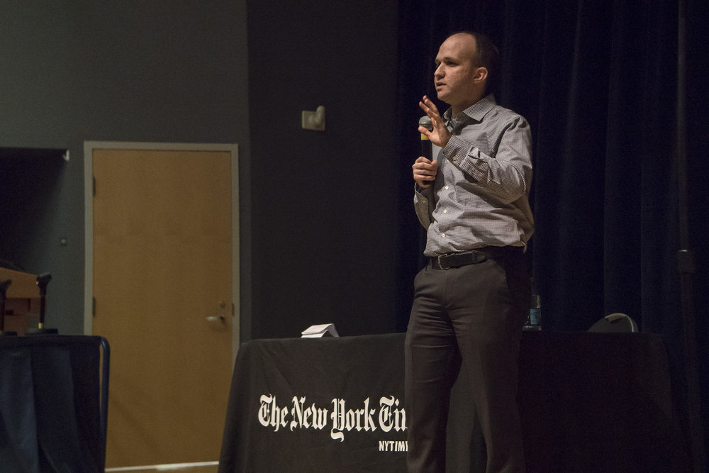 Steven Eder, an investigative journalist for the New York Times, explains the fast-paced environment of fact checking presidential debates on Monday, Oct. 24, 2016, in the Student Union Theater. (Bill Heyne/The Daily Campus)