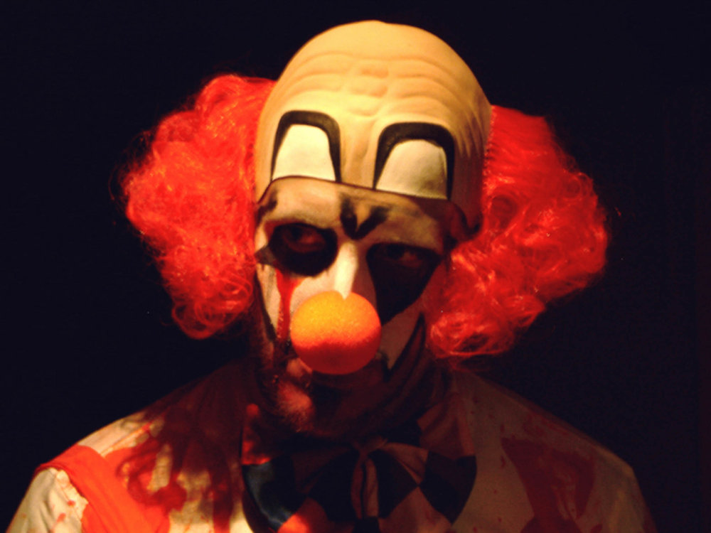 Have you ever met a clown that you've trusted? Ghosts are exactly who they appear to be, whereas who knows what's hiding underneath that clown mask or the makeup. (Graeme Maclean/Flickr, Creative Commons)