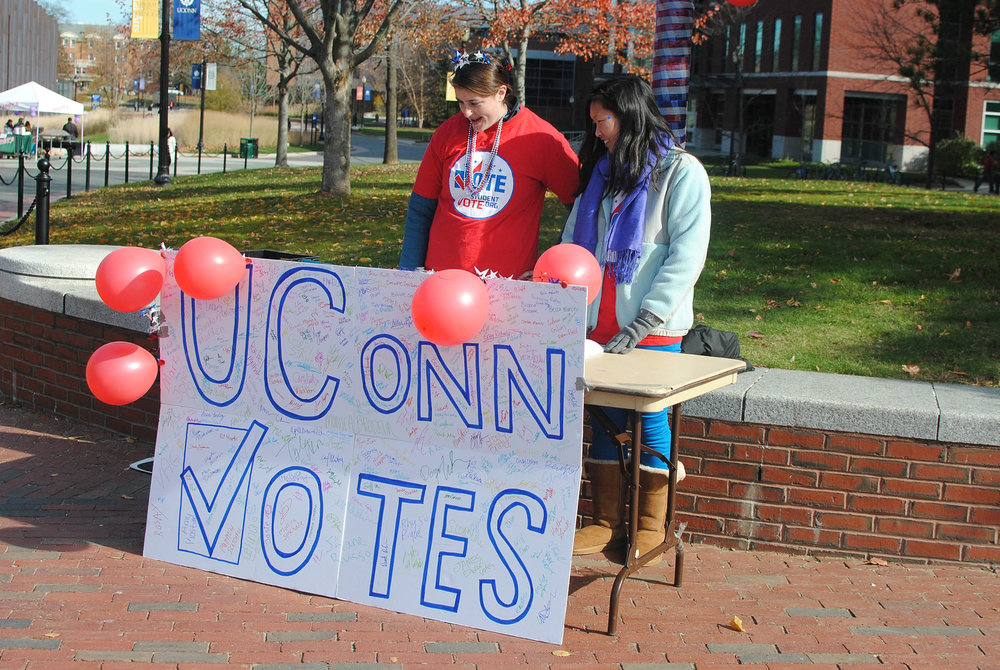 UConnPIRG tables on Fairfield Way to register students to vote in future elections. This year UConnPIRG has registered 2204 voters, just shy of their 2500 student goal. (File Photo/The Daily Campus)