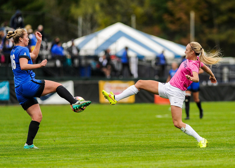 UConn forward Rachel Hill kicks a ball past a Memphis opponent at Joseph J. Morrone Stadium on Sunday, Oct. 2, 2016. The Huskies won 4-1. (Jason Jiang/The Daily Campus)