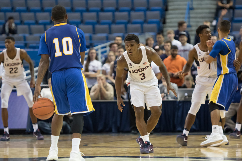 Freshman guard Alterique Gilbert stares down UNH's Danny Upchurch on defense during UConn's 83-68 win on Sunday, Oct. 30 at the XL Center in Hartford. Gilbert scored five points and recorded five assists in his Husky debut. (Jackson Haigis/The Daily Campus)