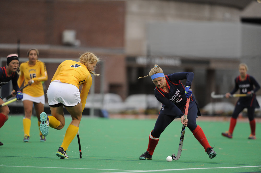 Freshman Svea Boker avoids Quinnipiac University's defenseman Lauren Belskie in Friday's home game.  Huskies capped off their season with a 5-1 win.  The ladies are setting their sights on the Big East conference and national tournament afterwards.     (Jason Jiang/The Daily Campus)