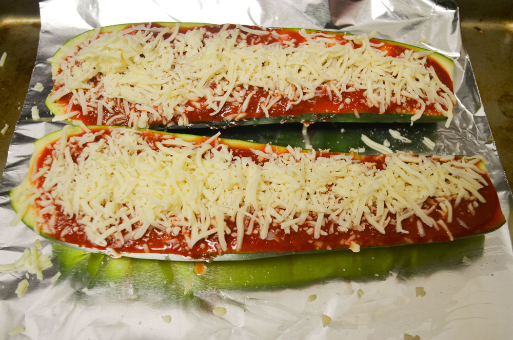 The finished product of zucchini pizza boats. The main ingredients pictures are zucchini, cheese and marinara sauce. (Claire Galvin/The Daily Campus)