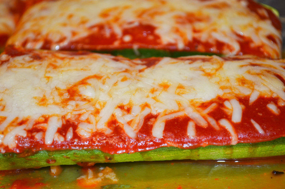 A close up view of the finished zucchini pizza boats. The recipe is meant to be more of a guideline and readers are encouraged to adjust ingredients as they please in order to create their perfect zucchini pizza boat. (Claire Galvin/The Daily Campus)