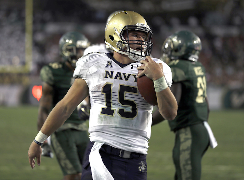 Navy quarterback Will Worth scores on a 1-yard touchdown run against South Florida during the third quarter of an NCAA college football game Friday, Oct. 28, 2016, in Tampa, Fla. Worth had four touchdown runs in Navy's 52-45 loss. (Chris O'Meara/AP Photo)