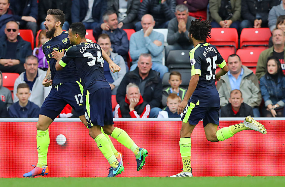 Arsenal's Olivier Giroud, left, celebrates scoring his side's third goal of the game with teamnate Francis Coquelin during their English Premier League soccer match against Sunderland at the Stadium of Light, Sunderland, England, Saturday, Oct. 29, 2016. (Owen Humphreys/PA via AP)