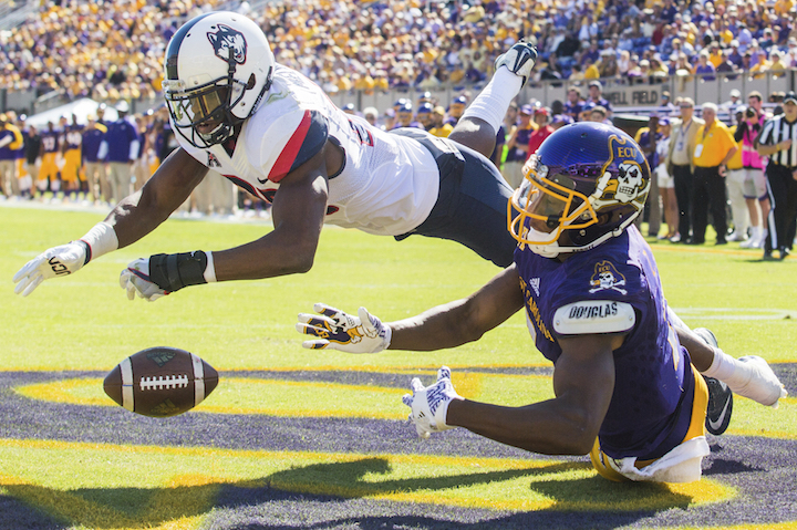 Connecticut's Obi Melifonwu (20) and East Carolina's Zay Jones (7) dive to catch a pass in the Pirates' end zone during an NCAA college football game Saturday. Oct. 29, 2016. in Greenville, N.C.. (Joe Pellegrino/The Daily Reflector via AP)