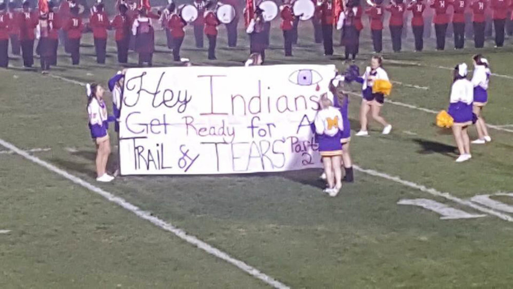 "Greenfield-McClain High School cheerleaders display a banner reading ""Hey Indians, Get Ready for A Trail of Tears Part 2"" ahead of their football game against Hillsboro High football game on Friday, Oct. 28, 2016 in Ohio. Many of found the banner to be racist and the school has since issued an apology. (Courtesy of Deadspin)"