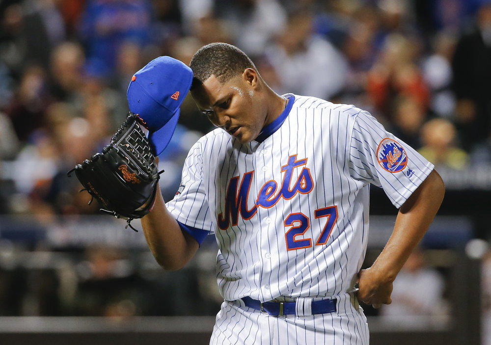New York Mets relief pitcher Jeurys Familia (27) walks off the field at the end of the top of the ninth inning after giving up a three-run home run to San Francisco Giants' Conor Gillaspie during the National League wild-card baseball game, Wednesday, Oct. 5, 2016, in New York. The Giants won 3-0. (Kathy Willens/AP)