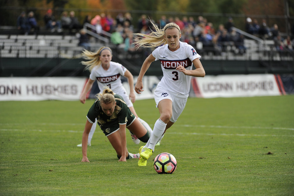 Senior Rachel Hill (3) dodges a USF player during the Huskies 3-1 victory over the Bulls on Sunday, Oct. 16, 2016 at Morrone Stadium. Hill took home the award for Co-Midfielder of the Year and for an impressive fourth straight season was named to the All-Conference Team. (Jason Jiang/The Daily Campus)