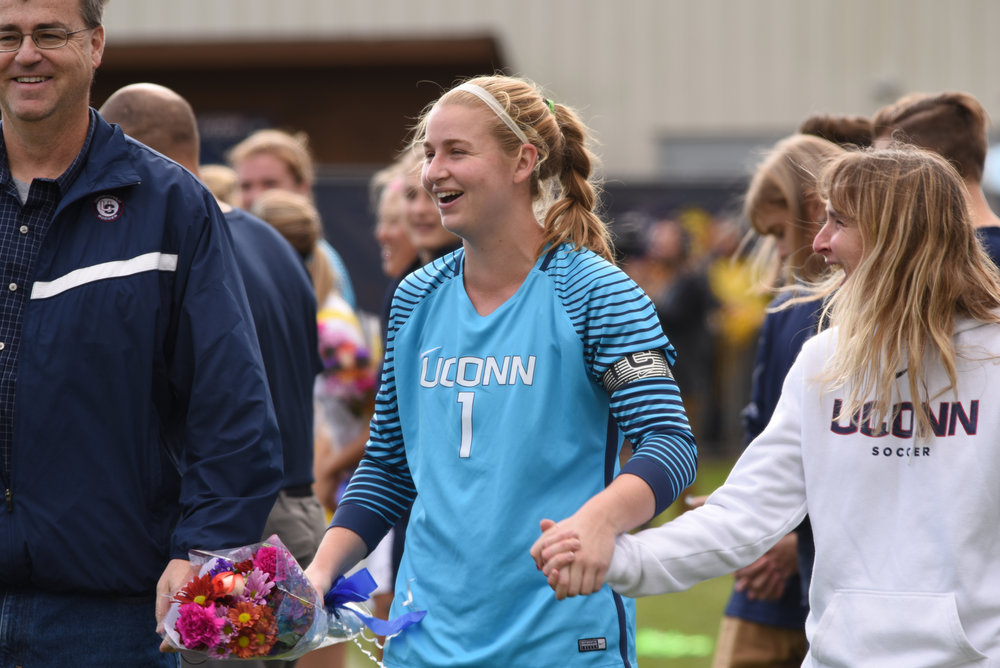 Senior goalie Emily Armstrong celebrates with her parents on Senior Day ahead of the Huskies 3-1 victory over the USF Bulls on Sunday, Oct. 16, 2016. (Charlotte Lao/The Daily Campus)