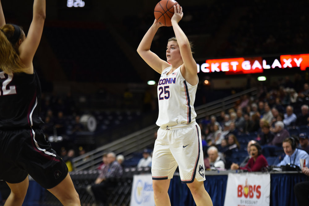 Freshman Kyla Irwin prepares to pass the Huskies 111-39 victory over the Indiana University of Pennsylvania Crimson Hawks in the team's exhibition opener at Gampel Pavilion. Irwin led the freshmen in points scoring 12 of the teams 111 points. (Charlotte Lao/The Daily Campus)