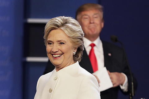Democratic presidential nominee Hillary Clinton walks off stage as Republican presidential nominee Donald Trump puts his notes away after the third presidential debate at UNLV in Las Vegas, Wednesday, Oct. 19, 2016.  Despite numerous opportunities, neither candidate has directly addressed climate change. (John Locher/ AP)