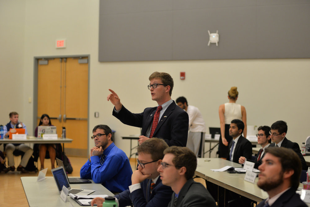 USG Senator Michael LaPorte proposes an amendment to a piece of legislature that would grand senate leadership funds for administrative purposes on Wednesday evening during the senate's biweekly meeting in the Student Union Ballroom. (Amar Batra/The Daily Campus)